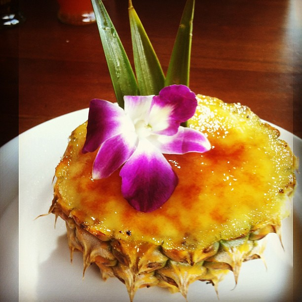 Coconut creme brûlée served in a pineapple.
