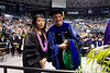 UH Manoa Communication and Information Sciences Program doctoral student Misa Maruyama was hooded by Professor Scott Robertson. Photo by Andrew Wertheimer