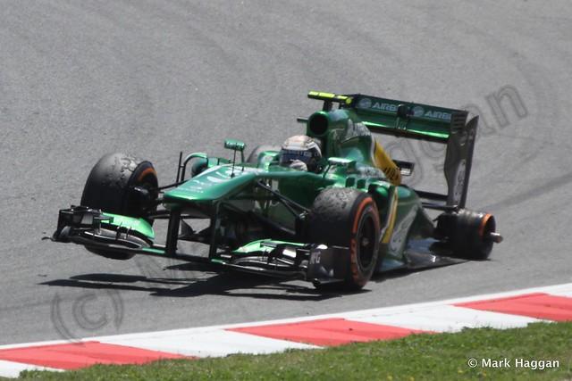 Giedo van der Garde's car afer losing a wheel at the 2013 Spanish Grand Prix