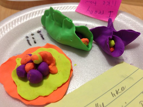 Creating something out of clay in writing workshop