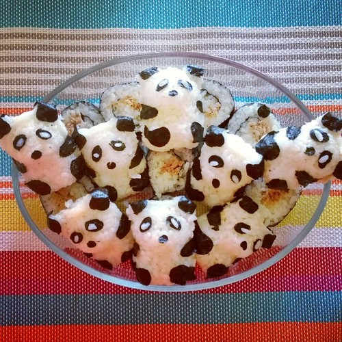 The boy is turning 10 in a couple of days and he's having his birthday party today. One item on the menu: tuna-mayo filled sushi (regular roll & panda-shaped! :)).