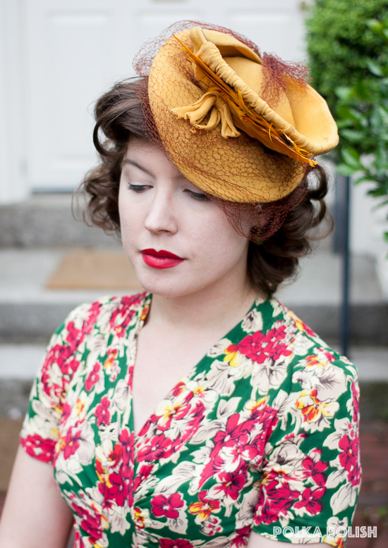 Goldenrod 1940s tilt hat covered in jersey fabric with a rust colored veil and feathers