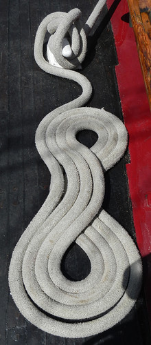 ropes (lines) on a boat arranged in a looped pattern