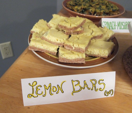 Plate stacked with lemon bars.