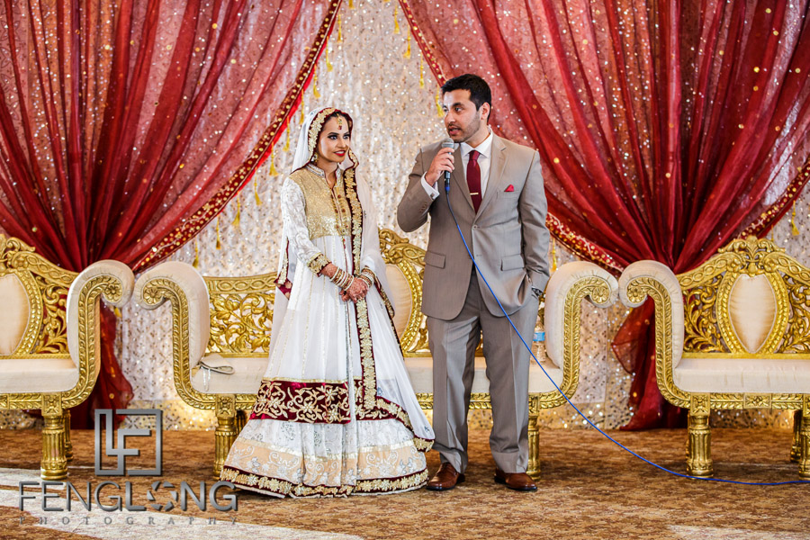 Bride and groom giving a speech during Indian wedding reception