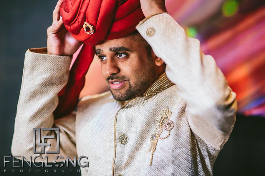 Indian groom puts on turban on his wedding day at the Ritz-Carlton Downtown Atlanta