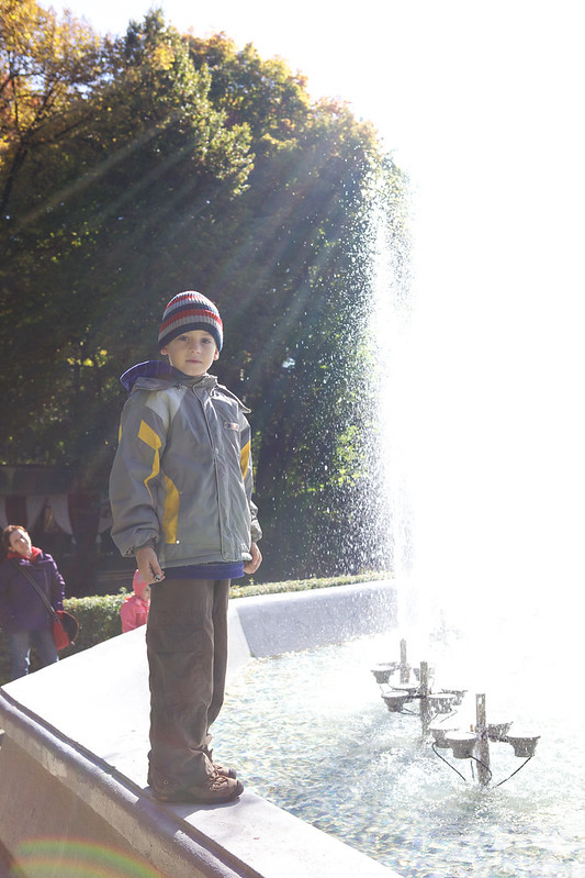A child next to the fountain. Striyskiy park, Lviv, Ukraine