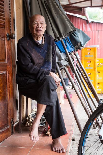 old man in market, Luang Prabang, Laos