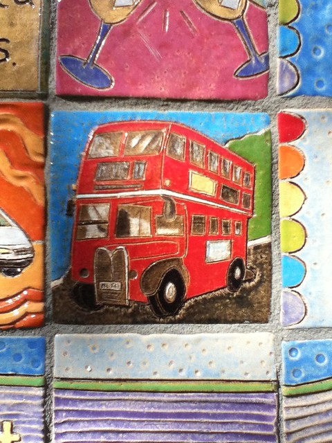 red bus tile on davis song mural