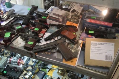 Fishing reels alongside replica pistols that shoot BBs