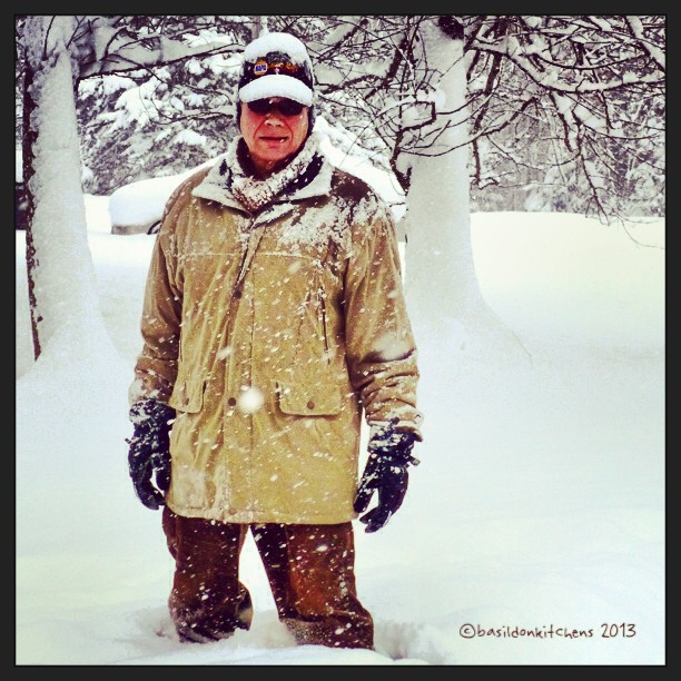Sep 23 (catching up) - bundled up {hubby is demonstrating one of last winter's snowfall; he is bundled up against the cold} #photoaday #snow #weather #parka