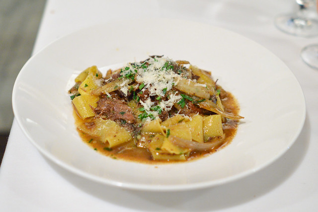 Pappardelle wide pasta ribbons, slow cooked short rib ragu, grated horseradish