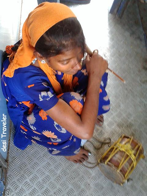 banjara girl with small drum dhol