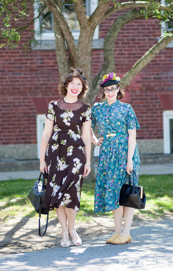 Vintage friends dressed in 1940s floral rayon dresses and tilt hats