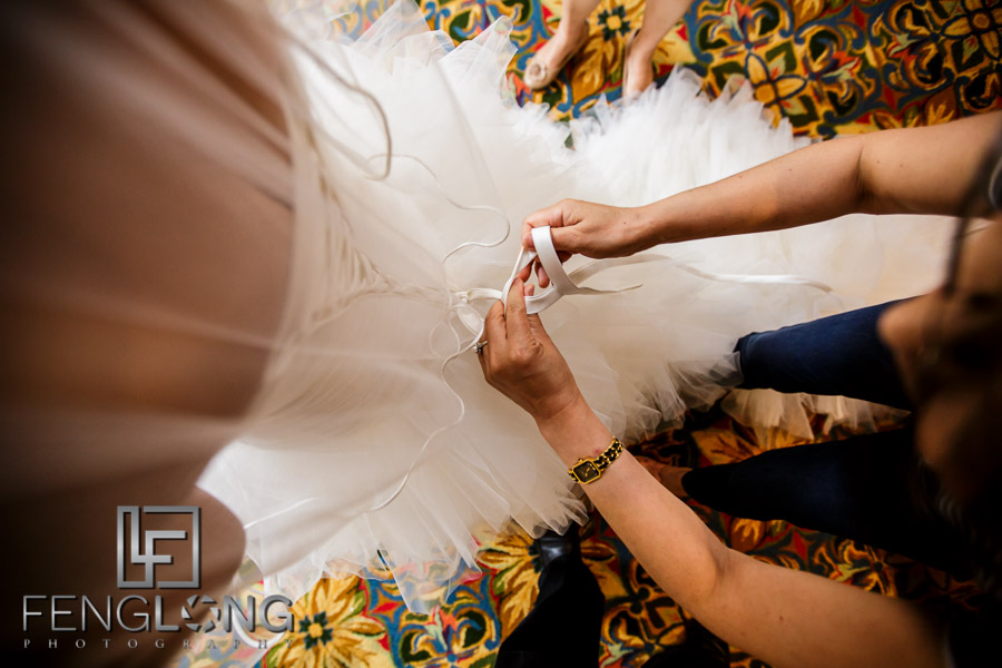 Chinese bride puts on her wedding dress