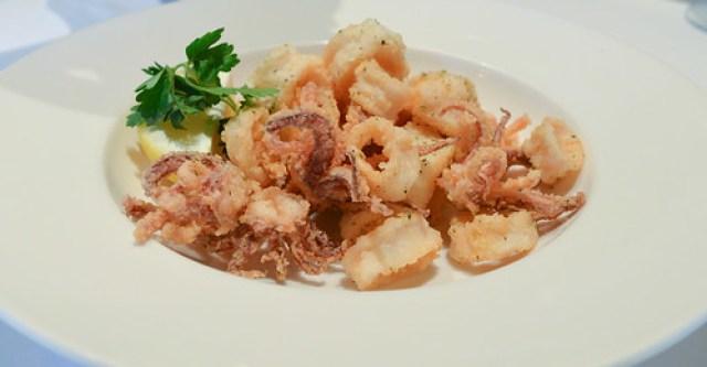 Fried Calamari fresh calamari, lightly fried with lemon