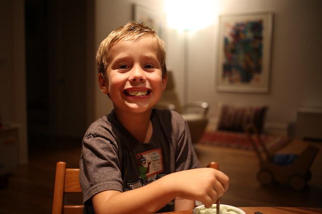 Lucas eats a mint yoghurt