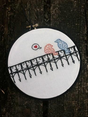 Love birds on a fence