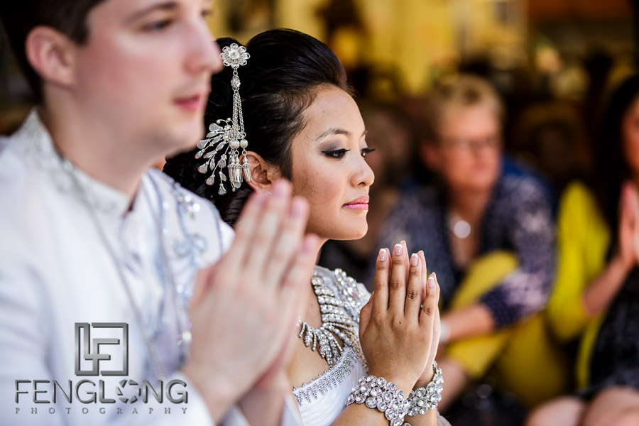 Cambodian bride prays during Buddhist wedding ceremony