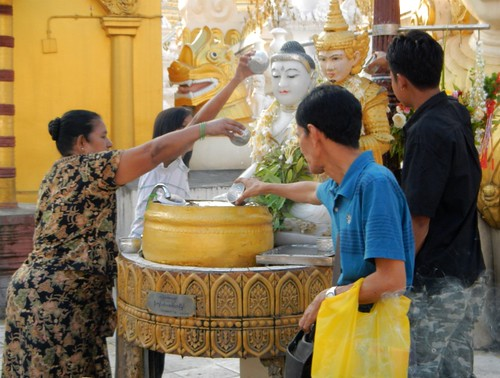 People worshipping the Buddha that represents the day they were born Golden Shwedagon Pagoda in Yangon, Myanmar.
