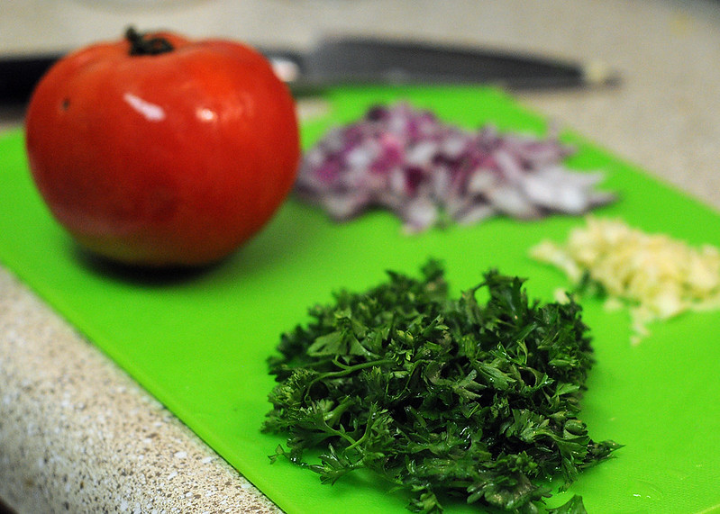 Tomato plus chopped parsley, red onion, and garlic