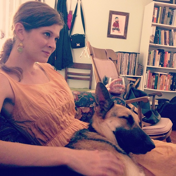 """My idea of a good night: wine, """"Breaking Bad,"""" and a shepherd sleeping in my lap. #draco #gsd"""