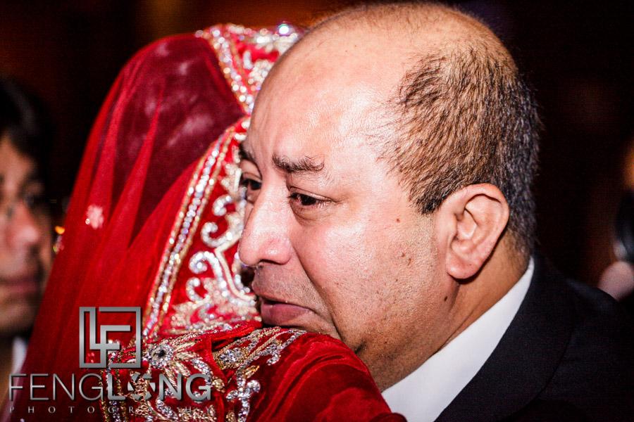 Bride hugs her father goodbye