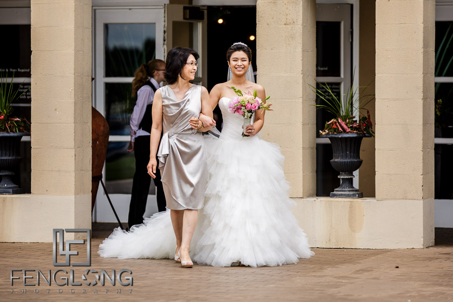 Bride and mother of the bride walk down the aisle