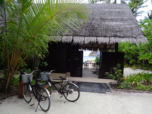 Reethi Rah Villa with personal bikes and beach side terrace.