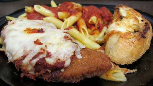 Chicken parmesan with pasta and garlic bread by Coyoty