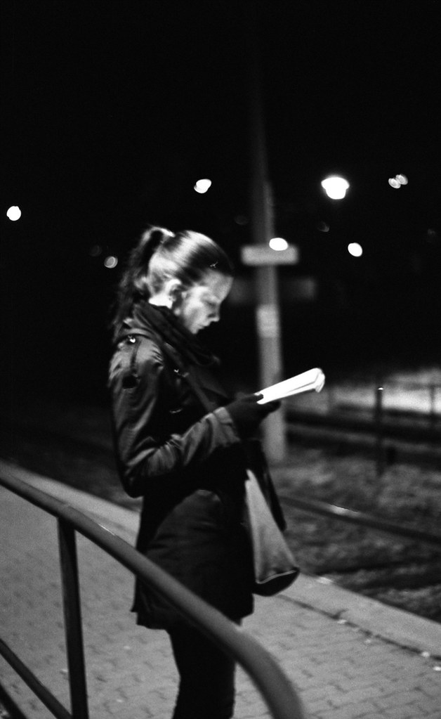 Praktica BC1 - Young Woman Reading at Tram Stop