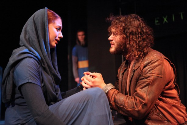 Claudio (right), played by Abdulrahim Harara, begs his sister, Isabella, played by Celeste Conowitch, to sacrifice her virginity to save his life as Friar Lodowick, played by Alex Skinner listens from afar, during Creative's State's production of Measure For Measure Wednesday, March 5. Photo by Lorisa Salvatin / Xpress