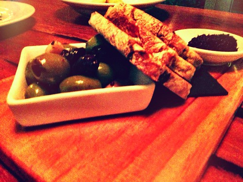 Pitted mixed olives, olive tapenade and olive bread