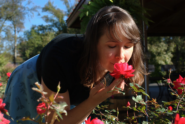 Yes, I do take time to stop & smell the roses!  (Photo by Pat Zimmerman.)