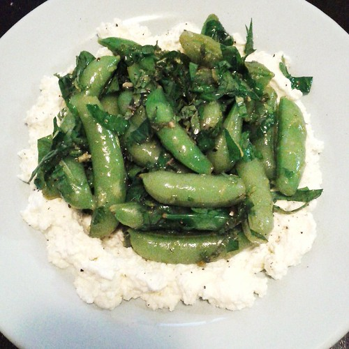 Sugar snap peas, mint, lemon over ricotta