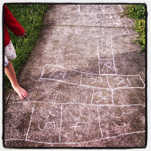 The longest game of hopscotch.   She is aiming for 100... #wondersifthepathislongenough