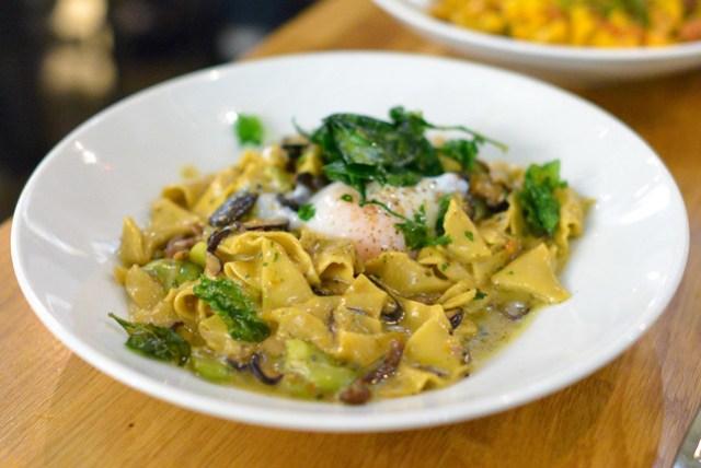 Porcini Pappardelle. hand-cut mushroom pasta. mixed mushroom ragu. pea tendrils. poached farm egg. fried spinach.