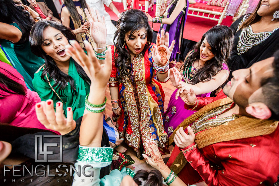 Indian bride dancing with guests during Pithi/Dholki night
