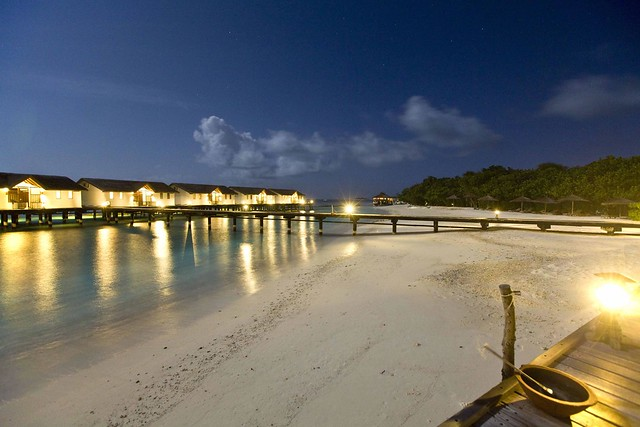 Night shot of Reethi beach resort water villa