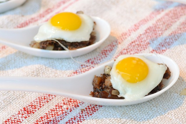 Caulfield's american wagyu belly hash, sunnyside quail egg, grilled chicory