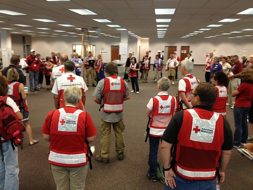 Red Cross volunteers gather for morning briefing