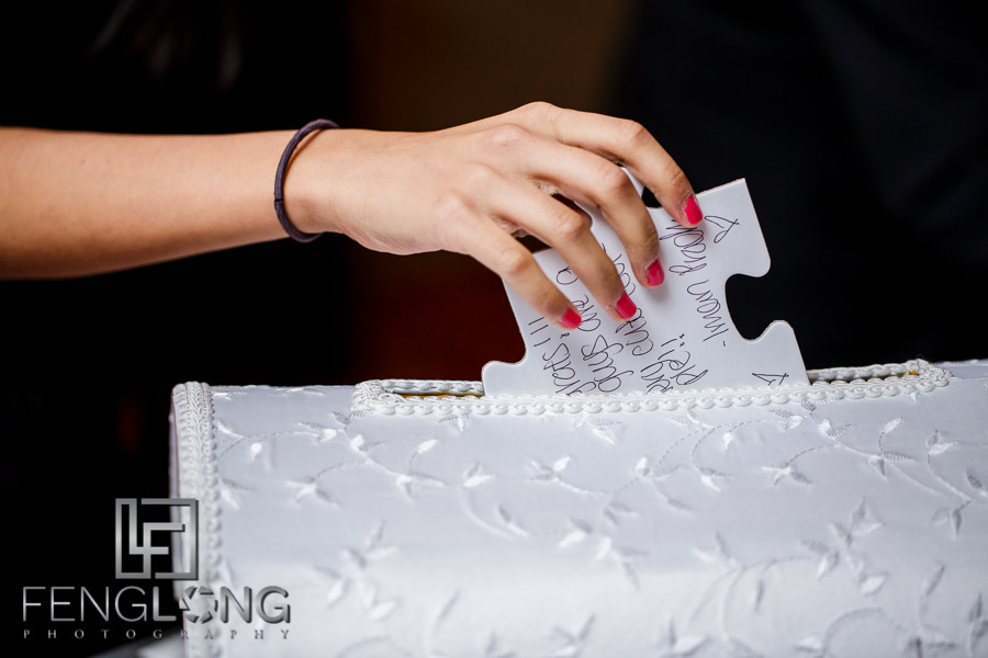 Guests sign into the wedding reception using puzzle pieces