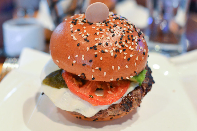 Hell's Kitchen Burger asadero cheese, roasted jalapeno peppers, avocado, oven roasted tomato