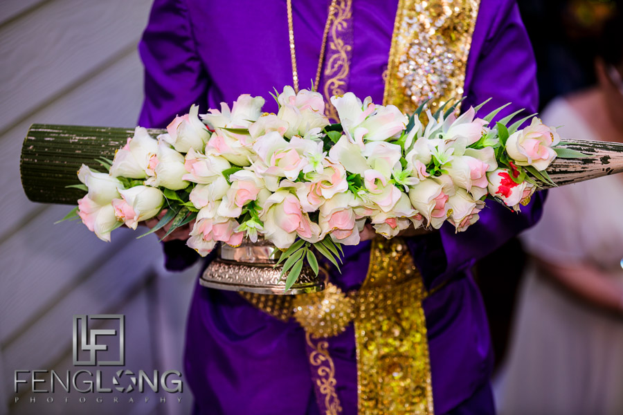 Cambodian bride dressing for her wedding day