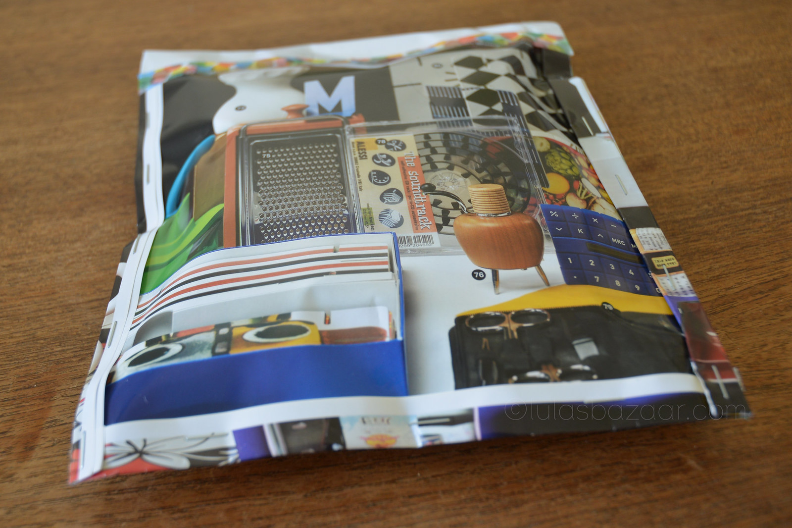 magazine pages used as gift wrapper for a boy's present.