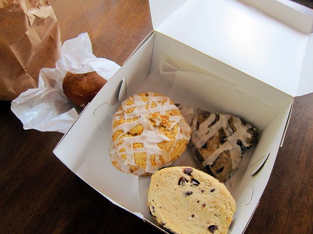 Top-down view of a bakery box filled with scones.