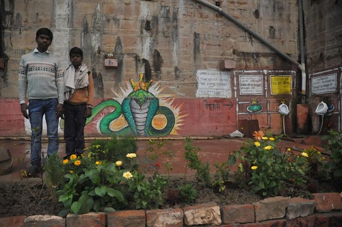 Deepak and Amit proudly posing at their outpost, Rana Pratap Ghat, Varanasi. You can see the toilet corner!