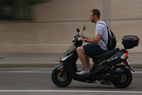 Guy on Scooter in the Grove