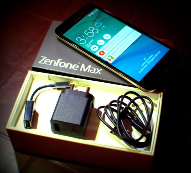 Asus Zenfone Max with the Accessories that came along with it..... No Head Phones...