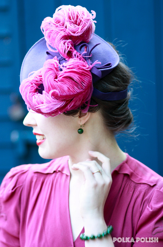 Swirling pink feathers top off a purple felt 1940s tilt hat by New York Creations